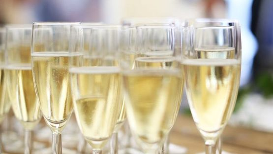 Champagne being served at a marquee event